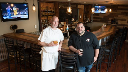 Head Chef Jon Traczyk, left, and General Manager Jonathan Crugnale stand by the Oak Bar at the White Horse Pub in Oaklyn, NJ.
