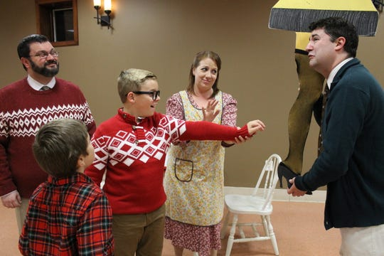 David Fusco (Jean Shepherd), from left, Michael LaMonaca (Randy Parker), Mason Corey (Ralphie Parker), Deena Osmer (Mom) and The Old Man (Jason Mangano) rehearse a scene with the legendary leg lamp in Sketch Club Players' 'A Christmas Story: The Musical.'