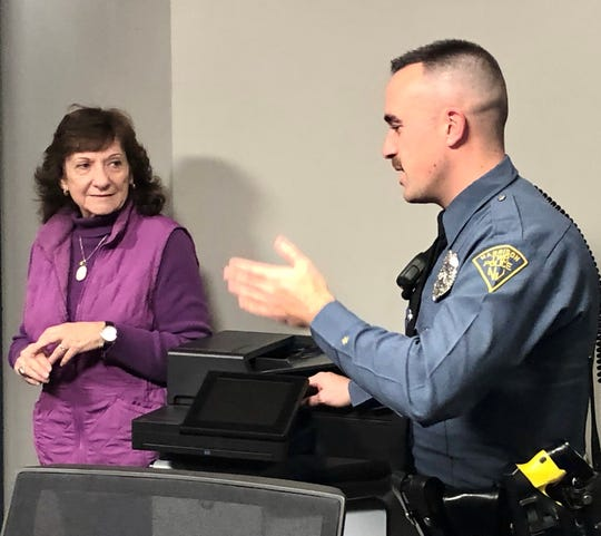 Cynthia Zardus of Harrison Township catches up with Patrolman Patrick Morris, one of the township officers who responded with lifesaving assistance when she was in cardiac arrest on Oct. 12.