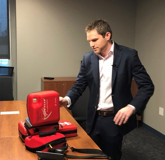 Dr. Rick Pescatore, an ER doctor and director of emergency medical services for Crozer-Keystone Health System, shows some of the defibrillators he purchased for the Harrison Township Police Department. Pescatore launched a GoFundMe campaign to help the department buy the medical devices.