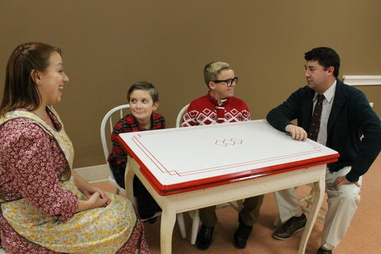 Deena Osmer (Mom), from left, Michael LaMonaca (Randy Parker), (Mason Corey (Ralphie Parker) and Jason Mangano (The Old Man) rehearse a scene from Sketch Club Players' 'A Christmas Story: The Musical.'