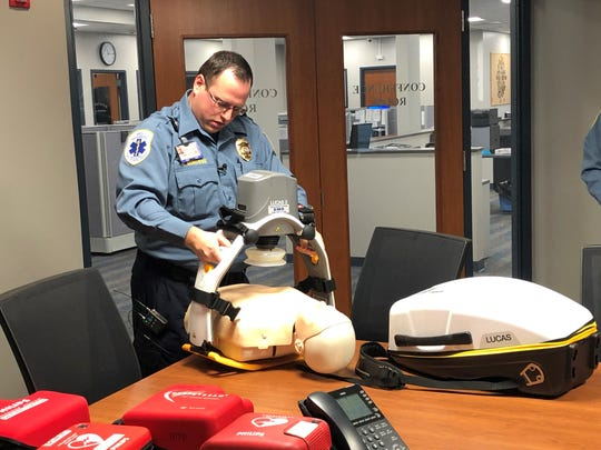 Gloucester County EMS supervisor Nick Minosse demonstrates a Lucas CPR device. The automated device, which was used in the emergency medical treatment of Cynthia Zardus, alleviates some of the fatigue EMTs can experience when doing manual chest compressions.