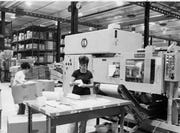 A worker packages products in the Rubbermaid plant shortly after it opened.
