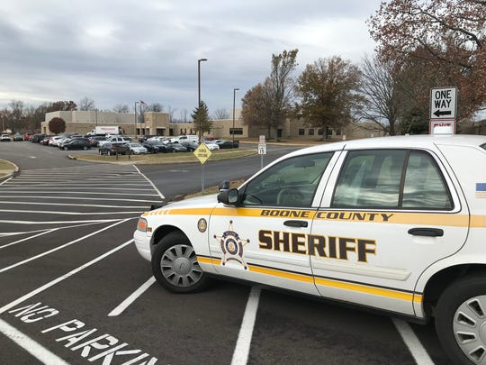 On Nov. 21, 2019, a Boone County Sheriff car is near the entrance to the campus of Ockerman Middle School in Florence in the upper portion of the photo a day after a 13-year-old Ockerman student was arrested on a felony terroristic threatening charge. Police said the boy reportedly threatened to shoot three eighth grade girls and seventh-grade students in general.