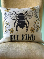A pillow is highlighted in the new Molly Bee's store in Clarksville.