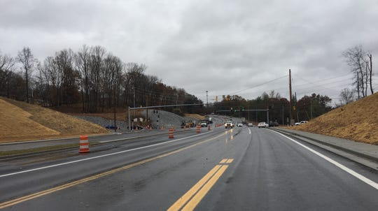 The widening of Warfield Boulevard is nearing completion on schedule, the state says.