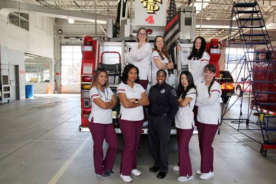 Accelerated 2nd Degree BSN Program students from the W. Cary Edwards School of Nursing's April 2020 cohort join Alisa McNeese – Trenton Fire Department's first female firefighter – recently in conjunction with the Ride-Along program. The program offers nursing students valuable exposure to pre-hospital patient assessment and care alongside Trenton Fire Department personnel. With McNeese (center front), from left to right are: students Priscilla Maldonado, Nkiru Izzuka, Rose Sierra and Karolina Dul. On the second row, from left to right are: Sidney Hamm, Carolyn Stone and Jenna Garofalo.