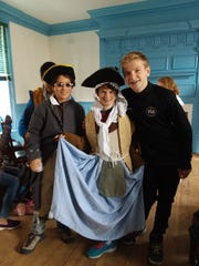 Luca DiGirolamo of Rahway, Sammy Faust of Westfield and Sebastian Martinez of Warren embrace the Colonial culture.