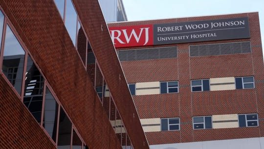 A Toms River woman is suing Robert Wood Johnson University Hospital, Rutgers Cancer Institute, RWJBarnabas and several doctors claiming that their negligence led to her husband's death.