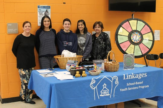 (Left to right) Linkages Substance Abuse Counselor Donna Lenox, SCVTHS Academy for Health & Medical Sciences sophomores Nabiya Chaudhry of Bridgewater, Christopher Masiello of Hillsborough, Rima Amin of Bridgewater and Linkages staff member Rose Murtagh pose for a photo in front of the exhibit.