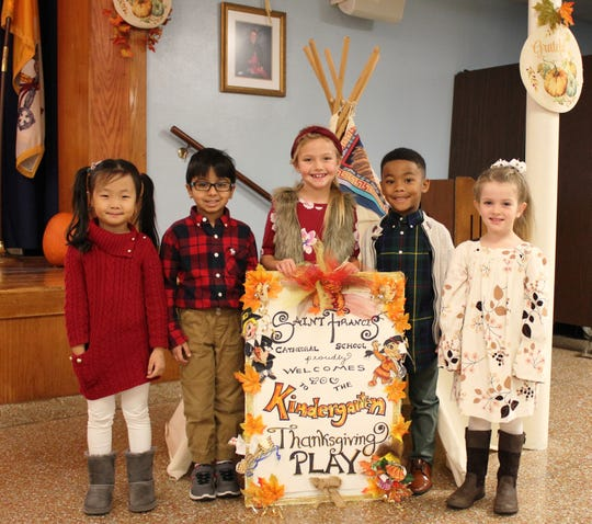 """St. Francis Cathedral School in Metuchen's kindergarten students performed in their annual Thanksgiving program, """"We Give Thanks"""" on Wednesday, Nov. 20. The children sang, danced and recited special prayers to kick off the holiday season. Pictured from left to right are: Nicole Hwang, Aarav Shah, Tessa Boyd, Nicholas Huntley and Maggie Killean."""