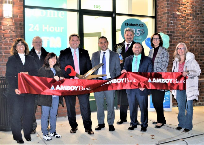 (Left to right) Kathy Romano, New Brunswick branch manager; Joe Razzano, Metuchen Chamber member; Dorothy Rasmussen, Metuchen Chamber councilwoman; Gregory Scharpf; Jonathan Busch; Brendan Flynn, Metuchen Chamber president; Jason Conway, Metuchen branch manager; Lorraine Mulligan, Metuchen Chamber member; and Patricia Lucas-Schnerre, Metuchen Chamber member.
