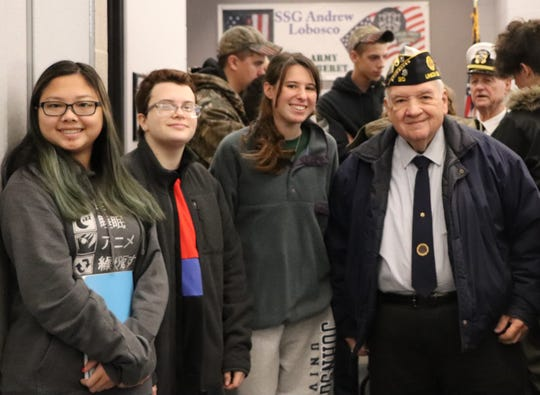 (Left to right) SCVTHS students Sarah Strano of Branchburg, Ari Carousso of Neshanic Station and Madison Weinberg of Hillsborough pose with former Union County American Legion Commander John Blank during the Attitude of Gratitude event.
