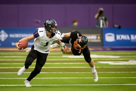 OABCIG's Cooper Dejean (1) is tackle by Waukon's Dawson Baures (3) during their Class 2A state football championship game at the UNI Dome on Friday, Nov. 22, 2019, in Cedar Falls. OABCIG takes a 17-6 lead over Waukon into halftime.