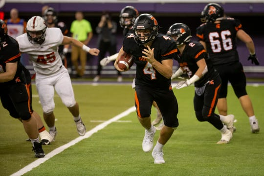 Solon's Cam Miller (4) rushes during their Class 3A state football championship game at the UNI Dome on Thursday, Nov. 21, 2019, in Cedar Falls. Western Dubuque would go on to defeat Solon 37-17.