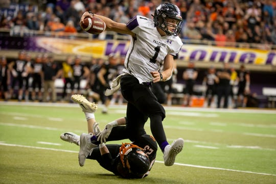 OABCIG's Cooper Dejean (1) runs over Waukon's Tyler Block (23) during their Class 2A state football championship game at the UNI Dome on Friday, Nov. 22, 2019, in Cedar Falls. OABCIG takes a 17-6 lead over Waukon into halftime.