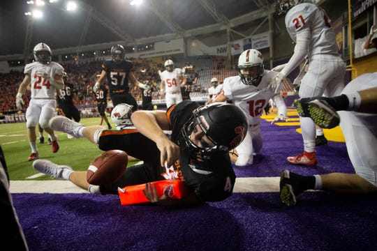 Solon's Cam Miller (4) crashes into the endzone during their Class 3A state football championship game at the UNI Dome on Thursday, Nov. 21, 2019, in Cedar Falls. Western Dubuque takes a 20-7 lead over Solon into halftime.