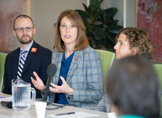 Rep. Cindy Axne, D-Iowa speaks with representatives from multiple child or family advocacy groups during a forum focused on fixing IowaÕs child care system Friday, Nov. 22, 2019.