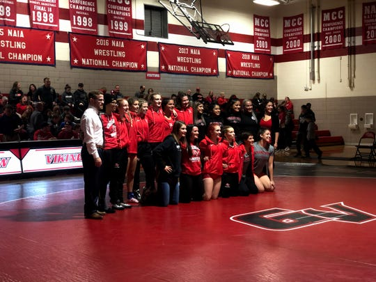 The Grand View women's wrestling team posed for a picture inside Sisam Arena on Thursday, November 21, 2019. Grand View beat Central Methodist, 29-17, for the first dual victory in program history.