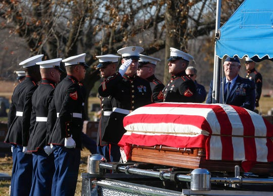 Members of the United States Marines serve as pallbearers during the burial service for Channing Whitaker, a Marine Corps Reserve Private who was killed in the South Pacific during World War II. Pvt. Whitaker was buried at the Glendale Cemetery in Des Moines on Friday, Nov. 22, 2019, surrounded by family from all over the United States.