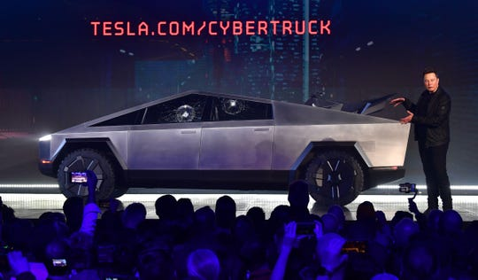 Tesla co-founder and CEO Elon Musk gestures while wrapping up his presentation of the newly unveiled all-electric battery-powered Tesla Cybertruck at Tesla Design Center on Nov. 21, 2019 in Hawthorne, Calif. (Photo by Frederic J. BROWN / AFP) (Photo by FREDERIC J. BROWN/AFP via Getty Images)
