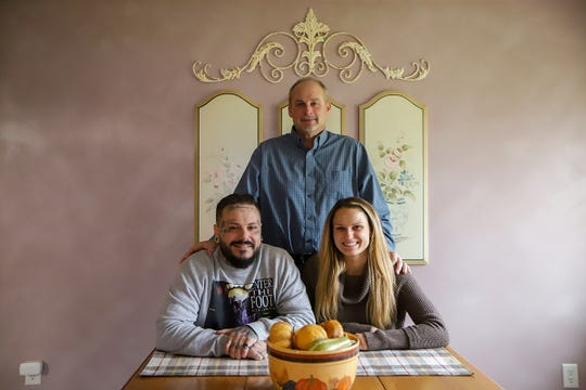 Tommy Kraus, 36, of Beverly Hills, left, has been clean and sober for five years and is rebuilding his life one day at a time and is photographed with his stepdad, Michael Todd, who he credits for his recent sobriety and his half-sister Christa Todd at their family home in Garden City, Mich. on Thursday, Nov. 21, 2019.