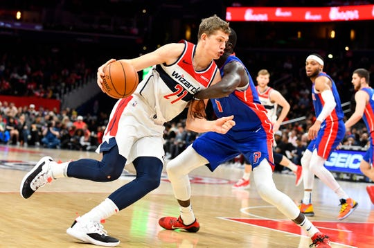 Wizards' Moritz Wagner dribbles as Pistons' Thon Maker defends at Capital One Arena, Nov. 4, 2019 in Washington.