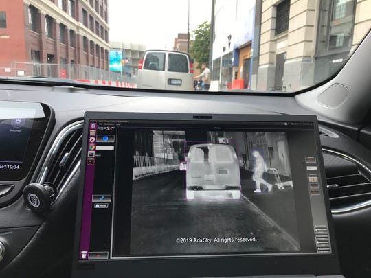 An image on a laptop screen shows what the AdaSky thermal camera sees during a demonstration, Oct. 21, 2019 in Detroit.