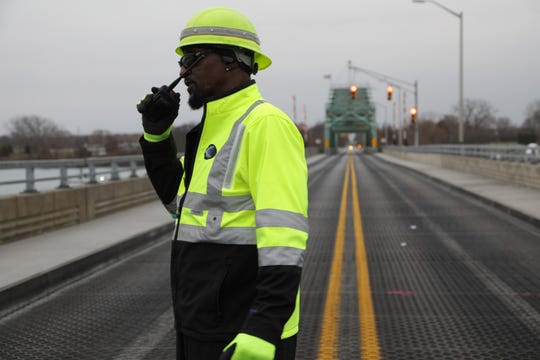Kevin Gunn, 60, of the Wayne County Dept. of Public Services officially radios to open the Grosse Ile Parkway Free bridge.