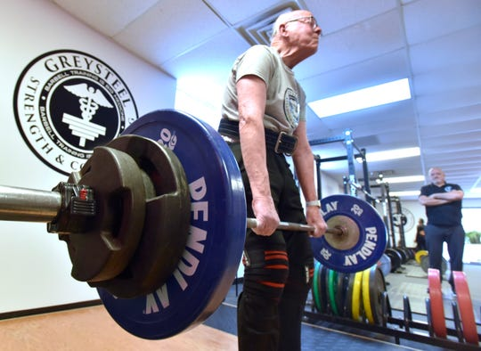 John Claassen, 93, of Plymouth lifts 205 pounds three times Friday while doing deadlifts in front of trainer Frank Psujek.