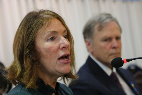 Cindy Warmbier, left, speaks as his husband Fred listens on, about their son Otto Warmbier who died after being released by North Korea in 2017.