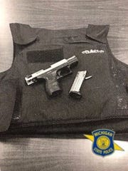 Michigan State Police said they arrested a man who was wearing a bulletproof vest and had a gun with the serial numbers removed after a traffic stop in Inkster. The man was a passenger in the vehicle.