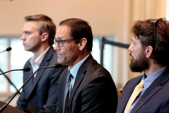 Mike Schyck, center, speaks along with Brian Garrett, left, and Dan Ritchie, right, during a meeting of the Ohio State University Board of Trustees on Thursday, Nov. 21, 2019, at the Longaberger Alumni House in Columbus, Ohio.