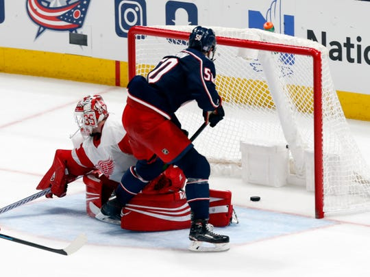 Columbus Blue Jackets forward Eric Robinson scores past Detroit Red Wings goalie Jimmy Howard during the third period Thursday night.