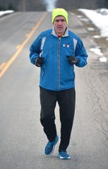 Anderson has logged more than 23,000 miles in the past 10 years, training and running races for charity.