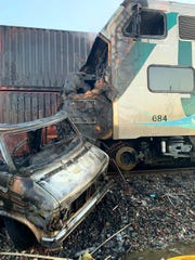 The scene after an RV was hit by a commuter train and burst into flames along a track in Santa Fe Springs, Calif.