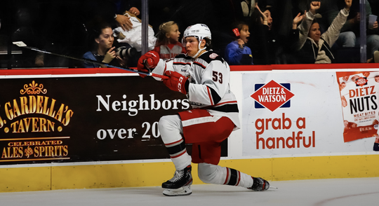 Grand Rapids defenseman Moritz Seider celebrates his first goal in the AHL.