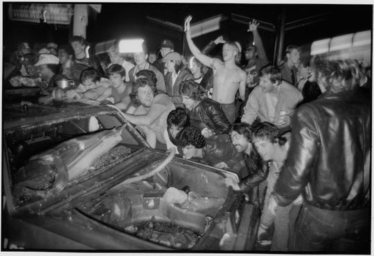 Photographer David Griffith caught exuberant crowds in the act of flipping a car right after the Tigers clinched the 1984 World Series.