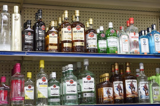 Rows of liquor bottles are on display at the Greenfield Party store in Oak Park.  But state liquor stores are experiencing dwindling supplies due to a problem with a distributor.