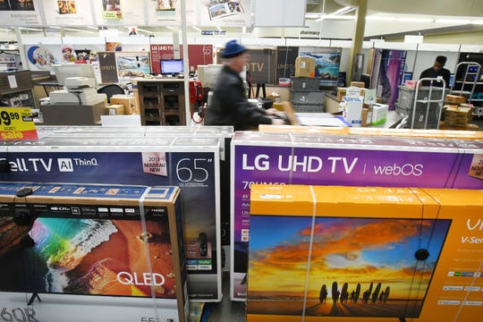Large flat-screen televisions are stacked in the aisles of the electronics department at Meijer in Detroit.