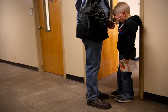 Eli, 6, has a difficult time being separated from his soon-to-be dad, Richard Colacecchi, before his Oak Hill Baptist Church Sunday school class last week.