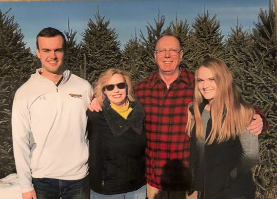 The Hanauer Christmas tree farm  in Shawano has been in operation since 1977. From left are Jack Hanauer, Julie Hanauer, Dan Hanauer and Sophie Hanauer.