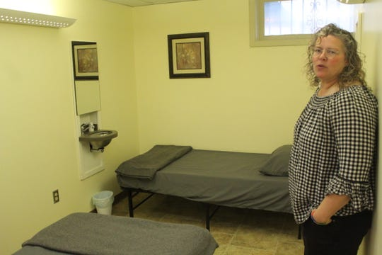 Director of Community Fortress Lynette Kirsch shows off a room where homeless people and families can stay in times of need.