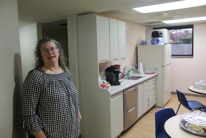 Community Fortress Director Lynette Kirsch shows off the kitchen where homeless people can receive a hot meal each night.