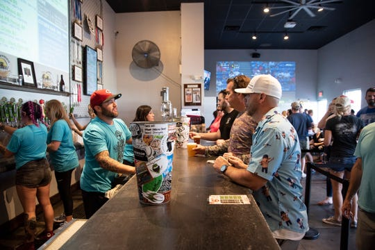 Customers sit at the bar at the Fort Myers Brewing Company.