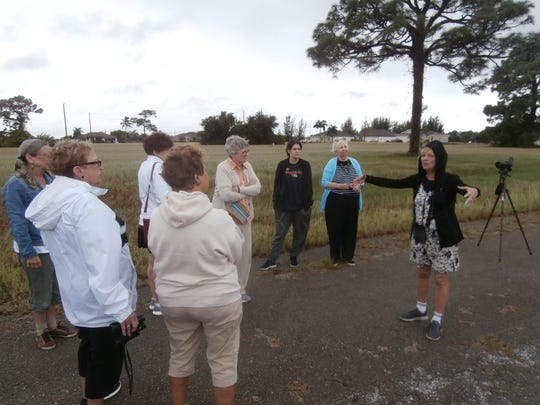 Cheryl Anderson, right, of Cape Coral Friends of Wildlife, describes the behavior of scrub jays during a stop on November's Nature of Cape Coral Bus Tour.
