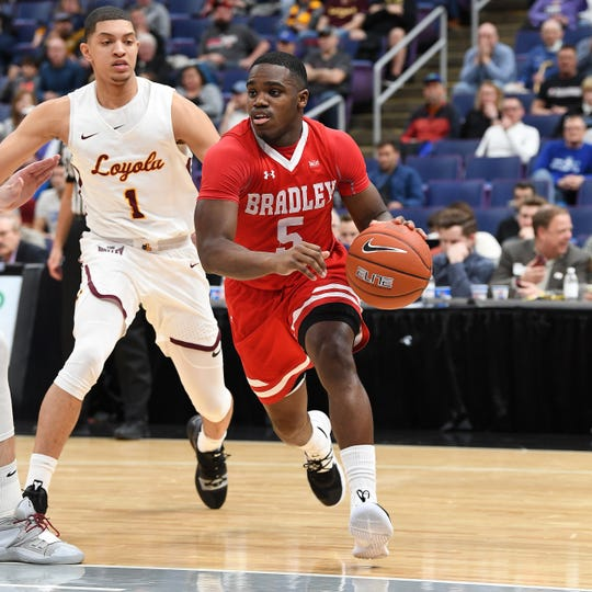 Bradley senior guard Darrell Brown, dribbling basketball, has been Bradley's go-to player, averaging nearly 14 points and seven points per game. He's seen here in the 2019 Missouri Valley Conference Men's Basketball Championship Tournament vs. Loyola Chicago this past spring.