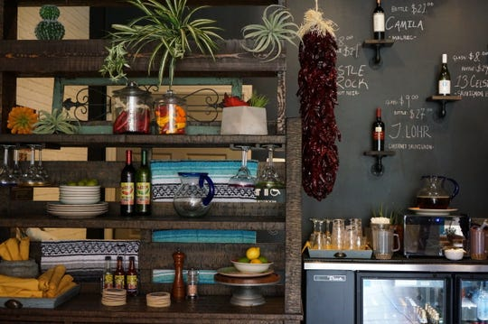 Tino's decor is filled with hand-crafted shelves and loads of chilies.