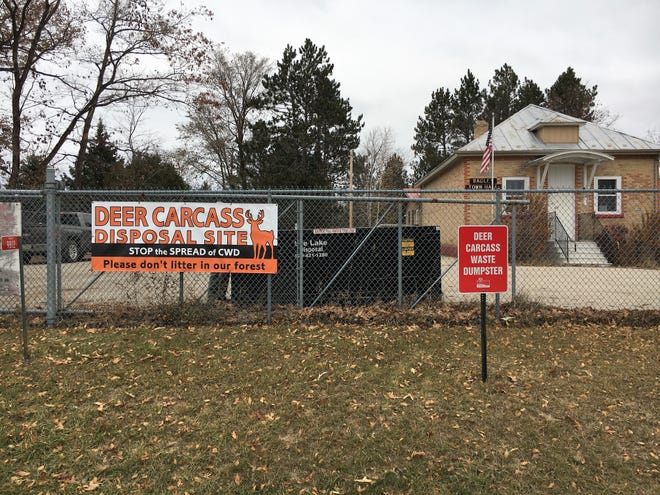 Signs point to a dumpster outside the Bagley Town Hall in Oconto County. The The Oconto County Sportsman Club Alliance and the Wisconsin DNR is urging hunter to use the this and seven other dumpsters throughout the area to dispose of deer carcasess during this hunting season.