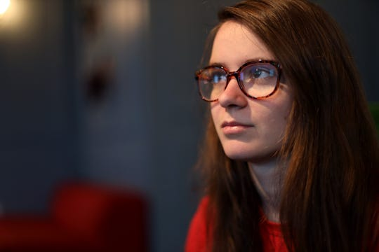 "Lena Stojiljkovic, a University of Wisconsin-Madison student, is seen in her friend's apartment in Madison, Wis., April 10, 2019. In the fall of 2016, she was hospitalized for a psychotic break and diagnosed with bipolar I disorder. ""I was smoking weed three, four times a day, every day, so that by the time November came, I was completely delusional."""